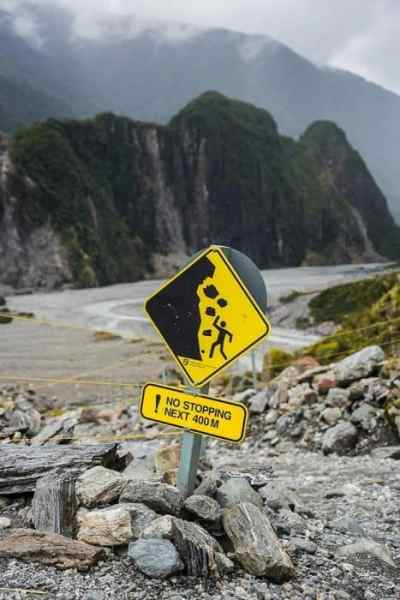 Fox glacier sign in cloudy weather in New Zealand, travel photography tips for beginners, Tips on travel photography, tips for travel photography, tips for better travel photos, How to take better photos, composition, Street photography, portrait photography, landscape photography,