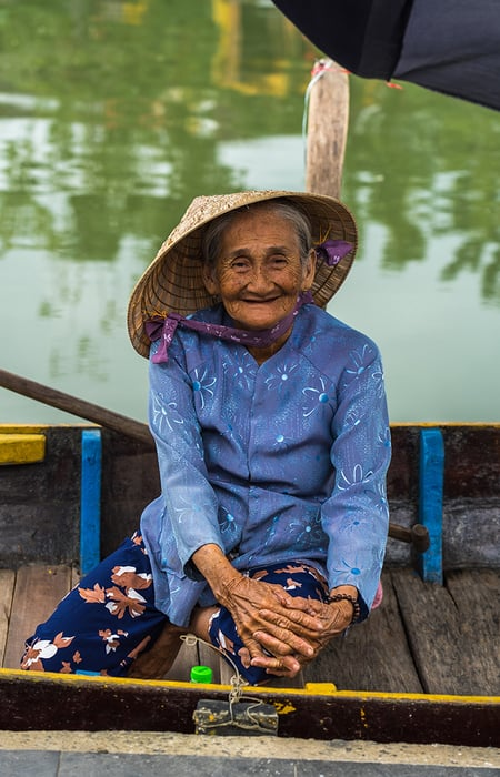 Vietnamese lady on a boat in Hoi An, 3 weeks in Vietnam, Vietnam itinerary: 3 weeks, 3 week Vietnam itinerary