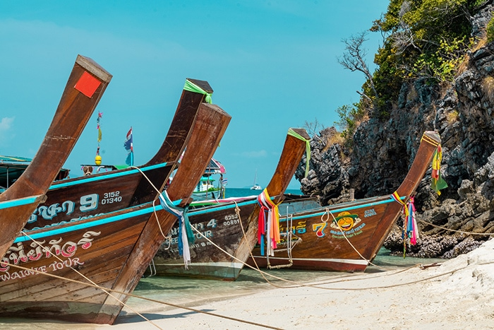 Traditional Thai long boats, (Phuket backpacking guide, budget Phuket, Phuket backpacker, Backpackers guide to Phuket, Phuket backpacker hostel, Best area to stay in Phuket, backpacking Thailand)