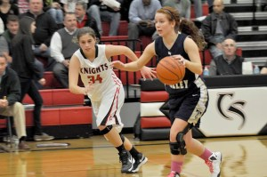 Hidden Valley senior captain Kelly King drives to the paint past Cave Spring defender #34 Courtney Stover.