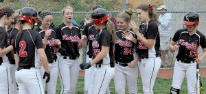 Cave Spring leadoff hitter Abby Beatty has a welcoming party waiting at the plate after she sent the game's first pitch for a home run. She added a two-run shot four innings later.
