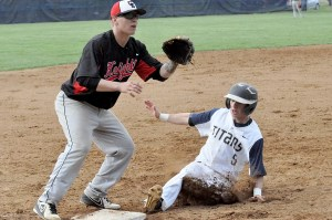Hidden Valley's Jack Moore slides safely into third as Cave Spring third baseman J.T. Roberts waits for the late throw.