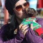 Sam kissing a cute puppy