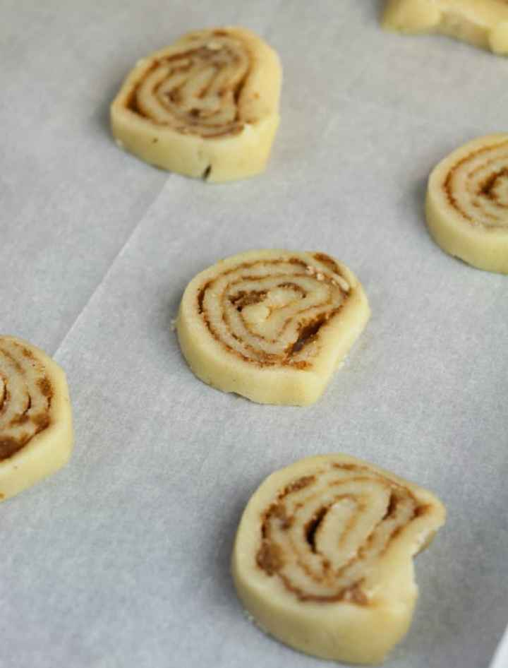 Cinnamon Bun Cookies - sliced cookies on baking sheet