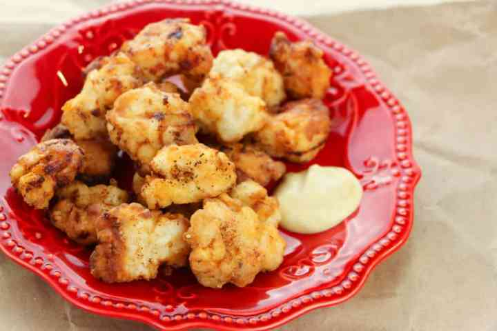 How To Make Copycat Chik Fil A Nuggets - served on a read plate