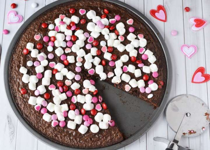 Valentines Day Brownie Pizza - brownie pizza with piece cut out
