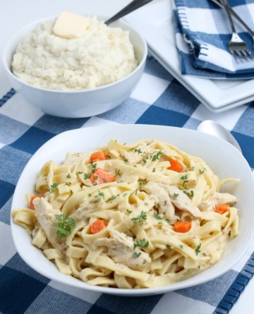 chicken and noodles in a white serving bowl