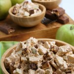 Apple snickers salad in wooden bowls