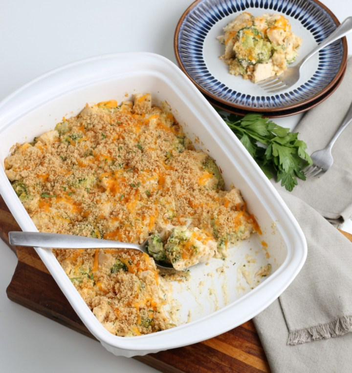 Creamy Chicken Divan in a baking dish with some removed