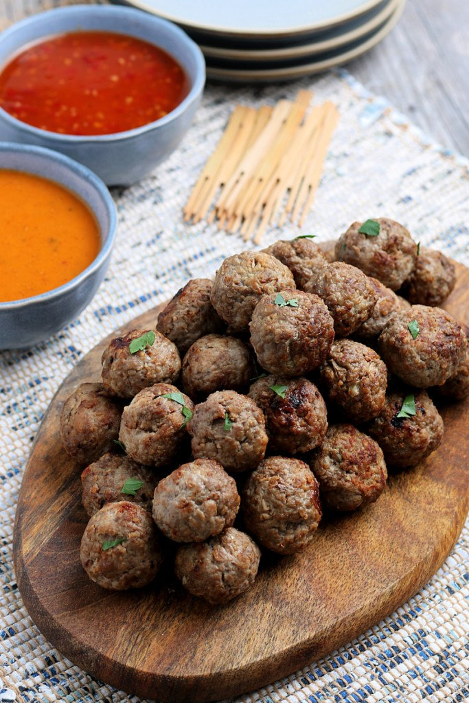 Meatballs stacked on a serving platter