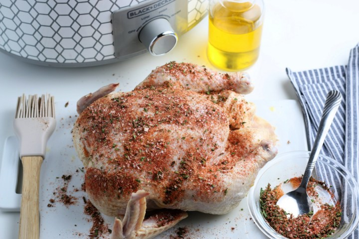 seasoning rubbed on whole chicken