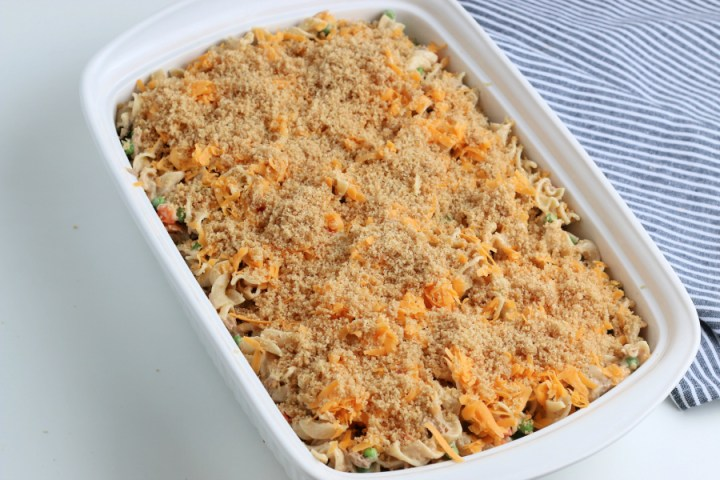 shredded cheese and bread crumble on top of casserole