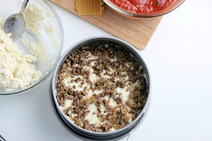 meat mixture placed on top of ricotta cheese mixture