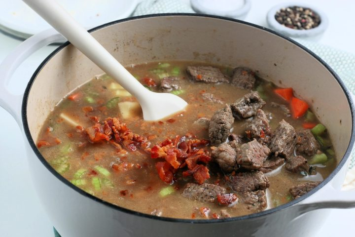 returning cooked beef to soup pot
