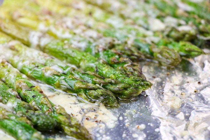 roasted asparagus on a foil lined baking sheet