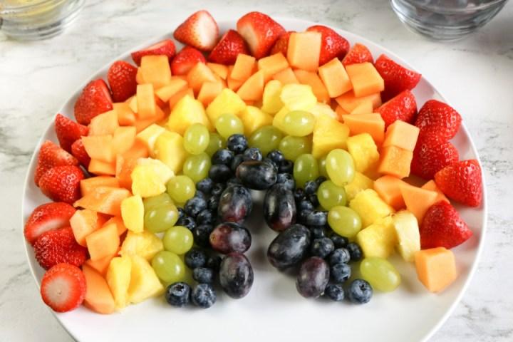 fruit arranged on a platter to look like a rainbow