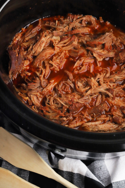 cooked bbq pork in a slow cooker