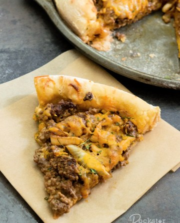 Slice of Patty Melt Pizza on a napkin