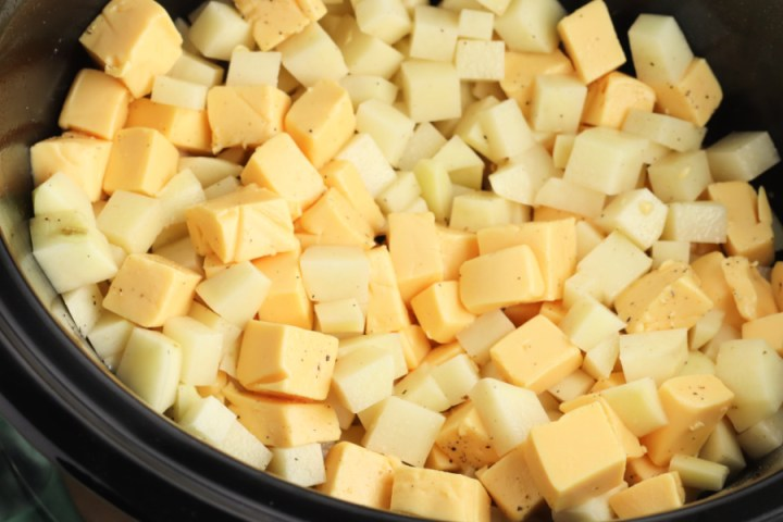 cubed potatoes and cheese in slow cooker