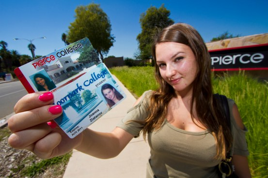 Joanna Zlatanov Poses with her two Student ID cards outside of Pierce College. Due to budget cuts Zlatanov had to enroll at Moorpark College in order to take the core classes that were unavailable to her at Pierce College. Photo: Jose Romero