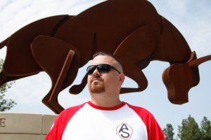 Associated Students Organization President Gustavo Sandoval, 31, says he is more of a person who gets things done than someone who only talks about doing things. He stands in front of the Pierce College Bull statue on Sept. 9. Photo by: Anabella Apfelbaum