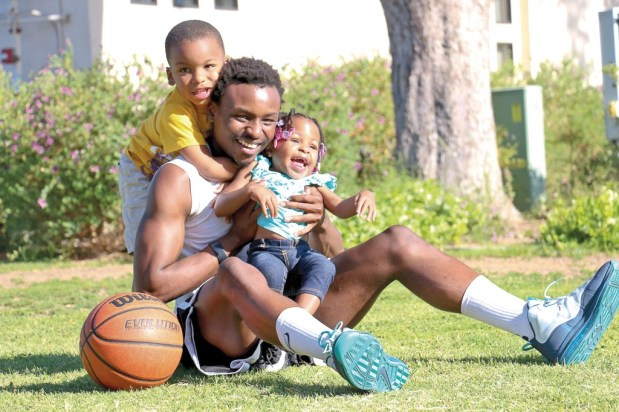 Lucious Coleman, a single father who attends Pierce College full time and plays for our school basketball team holds his daughter Remedy Coleman and son Kayden Coleman on April 24, 2014 at Pierce College in Woodland Hills CALIF. Photo: Giuliana Orlandoni