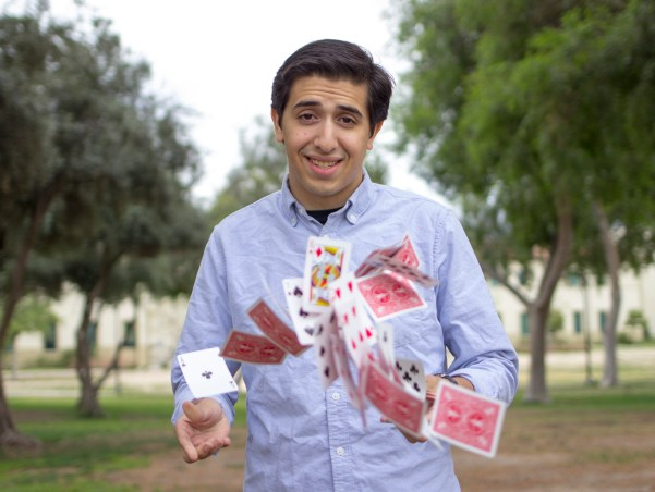 Magician and Pierce College student John Accardo lets his deck fly by the mall of Pierce College in Woodland Hills, Calif., Photo: Nicolas Heredia