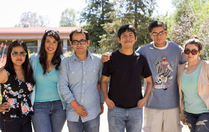 (left to right) Paloma Jacinto, Iris Delgado, Jesus Lara, Willy Morales, Edgardo Roncagliolo and Jaclyn Orellana of the We BUILD club pose in the Botanical Garden Thursday, May 15, 2014. The We BUILD club works to inform undocumented students of the financial options available to them.