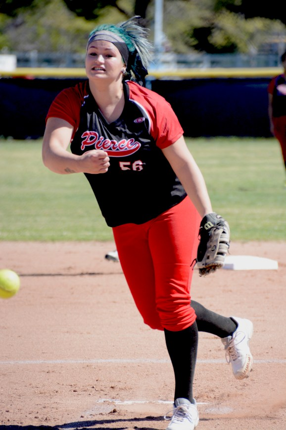 Katelyn Vogler of the Pierce College Women's Softball team pitching against San Bernardino Valley College on March 6th, 2015, 12pm game.  Woodland Hills, Calif. Photo by: Scott Aaronson