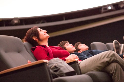 Pierce alumni Melissa Kevorkian and her two sons Preston Kevorkian and Evan Kevorkian look up at the ceiling of the planetarium at the Center for Sciences on Nov. 21, 2016 at Pierce College in Woodland Hills, Calif.