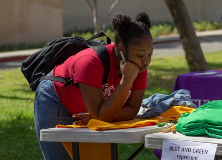 Zuri Jones-Walker prepares to writes her message during the Clothesline Project on Oct. 16, 2019 in Rocky Young Park at Pierce College in Woodland Hills, Calif. Hosted by ASO, the Diversity Committee and B.R.A.V.E., this event brings awareness to survivors of abuse by displaying messages or stories written by students. Photo by Angelica Lopez.