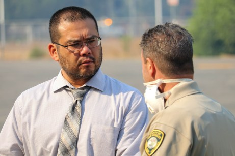 President Alexis Montevirgen talks to Officer Hugh from Los Angeles County's Animal Care and Control at Pierce College's Large Animal Evacuation Center at the Equestrian Center in Woodland Hills, Calif. due to the Saddleridge Fire on Oct. 11, 2019. Photo by Cecilia Parada.