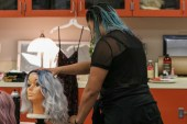 "Costume designer Melaney Garcia brushes out a wig for cast members to wear while performing in the production of ""Hookman"" in Pierce College's Performing Arts Building in Woodland Hills, Calif., on Oct. 25, 2019. Photo by Cecilia Parada."