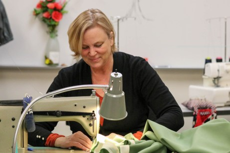 Katheryn Juday sews a piece of fabric in the Performing Arts Building at Pierce College in Woodland Hills, Calif., on Oct. 25, 2019. Photo by Cecilia Parada.