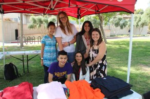 (Right to left,top)Vivian Yee, Jenni Severin, Jean Ibrahem (Right to left, bottom) Derek Laam, the teacher sponsor of the project and Nicole Ray pose underneath their tent on The Young Rocky Park at Pierce College Woodland Hills, Calif. on Oct. 16, 2019. Photo by: Kamryn Bouyett