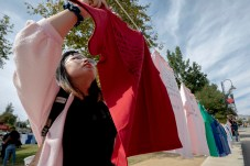 Vivian Thai hangs a t-shirt with her hand-written words printed on it at Rocky Young Park during the Clothesline Project on Wednesday, October 16, 2019, in Woodland Hills, Calif. (Photo by Kevin Lendio)