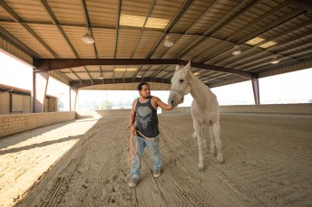 Eli Jordan walks his horse at the Pierce College Equestrian Center on Frday, Oct. 11, 2019, in Woodland Hills, Calif. Jordan evacuated from Porter Ranch along with her wife and their 4 horses due to the Saddleridge Fire. (Photo by Kevin Lendio)
