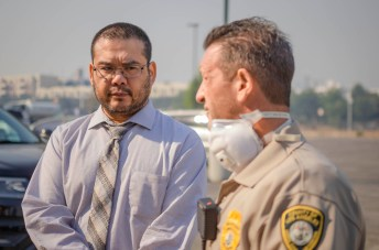 On the left, Pierce College President Alexis S. Montevirgen looks at Sheriff Bill Gruytch during a discussion about the status of evacuation activities on campus, on Friday, Oct. 11, 2019, in Woodland Hills, Calif. (Photo by Kevin Lendio)