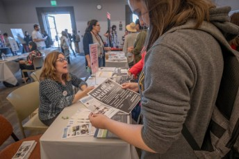 (Left) Denise Munro Robb, Ph.D., Associate Professor of Political Science, explains to students the offered programs at her department during the Meet Your Majors Fair at the Great Hall, Oct. 3, 2019, in Woodland Hills, Calif. Photo by Kevin Lendio.