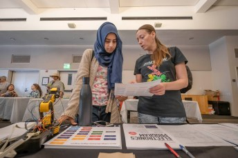 Lilach Farhy (right), a lab technician, explains to Narmeen Fatima (left) the programs offered at the Engineering Department during the Meet Your Major Fair. Photo by Kevin Lendio.