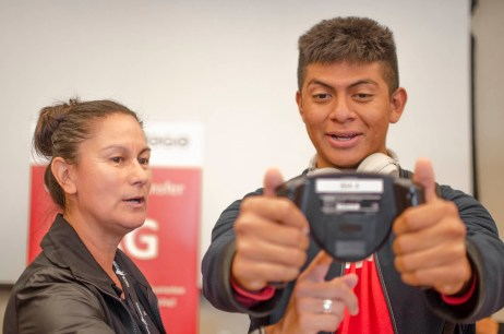 Nursing student Steven Duran tries out the Bio Electrical Impedence Analyzer (BIA) assisted by Susan Armenta, a professor in the Kineology department, during the Meet Your Major Fair at the Great Hall at Pierce College in Woodland Hills, Calif., on Oct. 3, 2019. Photo by Kevin Lendio.