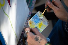 Jessie Sporer, Art 309 student and special effects makeup artist, paints two flowers on her once empty canvas atop the Art Hill in Woodland Hills, Calif., on Oct. 24, 2019. Photo by Sophia Gomez.