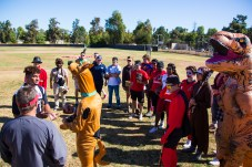 Players watch as Leon jackson and Jackson Briscoe play Rock Paper Scissors to determine who bats first before Pierce College Baseball's Halloween Backwards Game at Joe Kelly Field in Woodland Hills, Calif. on Oct. 31, 2019. Photo by Benjamin Hanson.