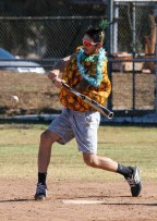Chris Hammond swings at the ball during a split-squad Halloween game at Pierce College's Kelly Field on Oct. 31, 2019. Photo by Cecilia Parada.