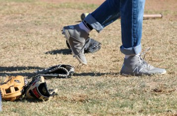 Gloves on the field during a split-squad Halloween game at Pierce College's Kelly Field on Oct. 31, 2019. Photo by Cecilia Parada.
