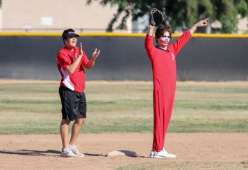 (Left to right) Kenny Baumgartner and Alex Owens react after a play during a split-squad Halloween game at Pierce College's Kelly Field on Oct. 31, 2019. Photo by Cecilia Parada.