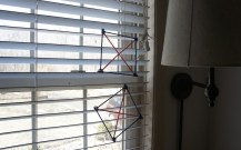 """""""kites"""" hanging in the window."""