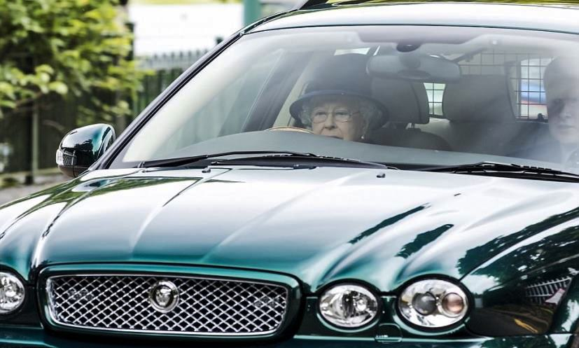 Queen Elizabeth driving Jaguar