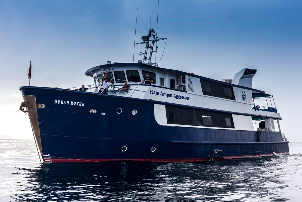 The Raja Ampat Aggressor from outside. A blue steel ship with the original name - Ocean Rover - still showing.