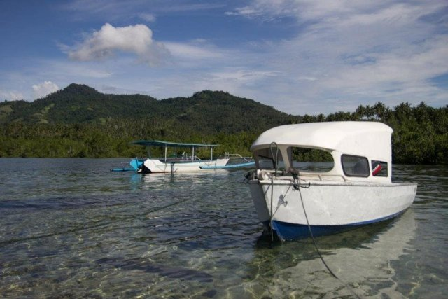 Dive Indonesia - Two boats in Manado. The water is so clear, you can see all the way to the bottom